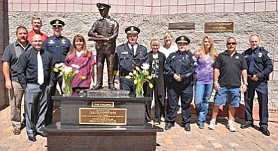 Statue Committee members (l-r) Jim Iacovacci, Dick Murie, John McTurk, Kevin Murie, Julie Murie,  Chief Jody Fanning, (statue), Diana Lassen-Joens, Melissa Stearley, Monica Kuhlt, Paul Lagoy,  Curt Glassman, Tate Stearley. Committee members not shown include Monette Fanning, Jeff Jones, Sculptor Neil Logan, Allen Marx and Cheri Marx VVN/Jon Pelletier