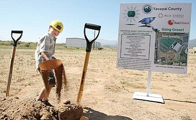 Five-year-old Alden Webb, grandson of Yavapai County Facilities Director Ken Van Keuren, takes a turn shoveling dirt following Friday's groundbreaking ceremony for a solar field and parking canopies at the Camp Verde Detention Center. VVN/Bill Helm