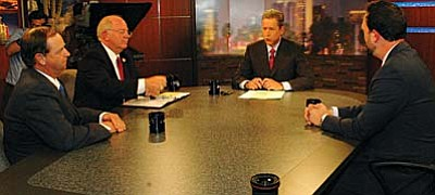 (Capitol Media Services photo by Howard Fischer) <br>Gary Kiene, Andy Tobin and Adam Kwasman, candidates for the state's first congressional district, debate Monday night at KAET-TV with host Ted Simons in the center.