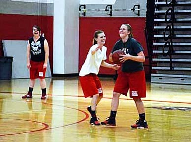 Kylie Streck guards Sharon Rehborg and has a laugh during practice. VVN/Travis Guy