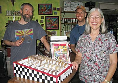 Tony Fanelli of Bike and Bean and a customer flank Carol Gronewold and her display of Secret Recipe goodies.