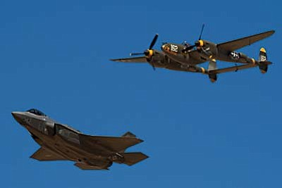 Todd flying the Lockheed F-35 Lightning II at the Luke AFB Airshow in March 2014 in formation with a Lockheed P-38 Lightning like those Ralph flew in WW II. (photo: Geoffrey  Arnwine)