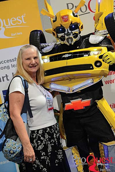 Cheryl Yeatts pictured with a Transformer at ALA Conference:Transforming Our Libraries, Ourselves.