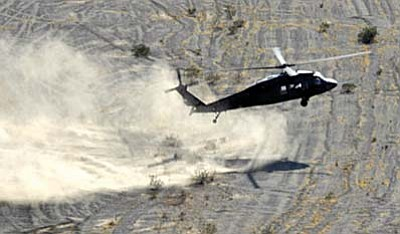 NASA photo<br /><br /><!-- 1upcrlf2 -->This photo of a UH-60 Blackhawk performing test landing in brownout at Yuma Proving Grounds was used by NASA in a field study of rotorcraft downwash flow.<br /><br /><!-- 1upcrlf2 -->