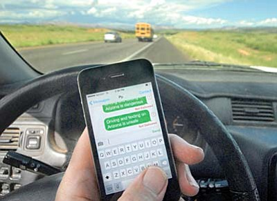 Sedona's law to regulate drivers distracted by texting went into effect Aug. 22 and mirrors a similar law recently passed by Coconino County.Photo illustration by Vyto Starinskas/VVN