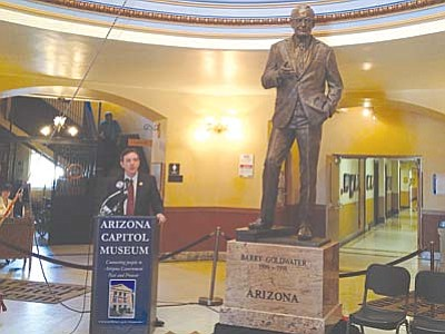 At its unveiling in March, Secretary of State Ken Bennett discusses a new statue honoring late U.S. Sen. Barry M. Goldwater that will represent Arizona at the U.S. Capitol. (Cronkite News Photo by Catherine Calderon)