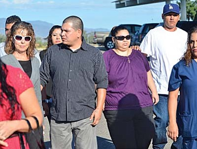 Angel Gonzalez, middle left, and Johanora Gonzalez Chavez, middle right, walk with supporters into court for the hearing of Cecilo Cruz on Thursday morning in Camp Verde. Cruz is accused of killing their sister Marisol Gonzalez 17 years ago. VVN/Vyto Starinskas