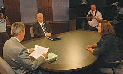 State House Speaker Andy Tobin and incumbent Congresswoman Ann Kirkpatrick face off Wednesday at KAET-TV with host Ted Simons.  (Capitol Media Services photo by Howard Fischer)