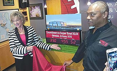 Sherry Henry, executive director of Arizona Office of Tourism, and Terry Williams, sales and service manager for the Glendale Convention and Visitors Bureau, address a February 2014 news conference counting down to the 2015 Super Bowl in Arizona. (Cronkite News Photo by Jordan Young)