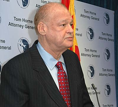 Attorney General Tom Horne explains Friday why he chose not to appeal a judge's order voiding Arizona's constitutional provision defining marriage as solely between one man and one woman.  (Capitol Media Services photo by Howard Fischer)