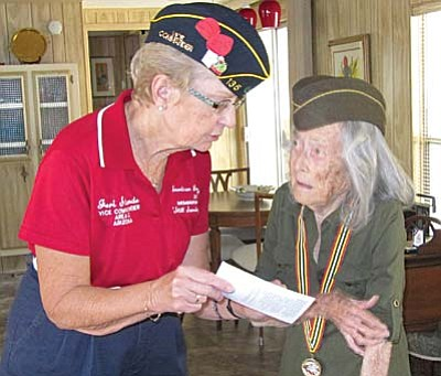 Jeri Strande (left) of the Cornville American Legion Post 135 presents post member Emma De Haven-Gleason-Berger with her travel voucher for herNov. 4-6 visit to Washington DC to visit her service-era memorial, the World War II (WWII) Monument along with other WWII veterans from across the country.