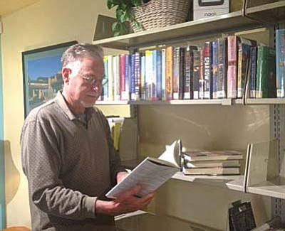 Dan Cothran browses the shelves at the Village library.