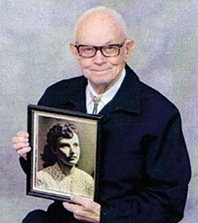 John A. McDonald holding a photograph of Ruth Elaine McDonald, his wife of 58 years, who passed away Dec. 26, 2008. (See her 2008 obituary below.)