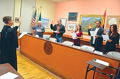 The Jerome Council is sworn-in during the Jerome Town Meeting Wednesday night. They are left to right, Mayor Lew Currier, Vice-Mayor Doug Freund, Councilmember and outgoing mayor Nikki Check, Councilmember Abe Stewart and Councilmember Alex Barber. VVN/Vyto Starinskas