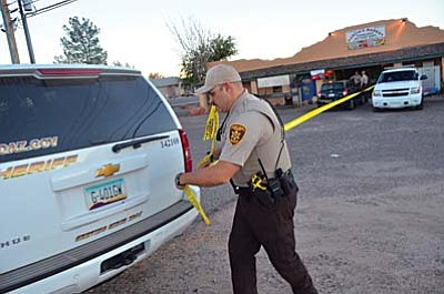 Yavapai Sheriff's Department deputies secure the scene around Garcia's Market in Cottonwood on Monday afternoon after a robbery involving a knife. VVN/Vyto Starinskas