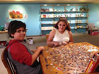 Laura and Brian Galvez enjoy the Sedona Public Library in the Village. Photo courtesy of Cheryl Yeatts.