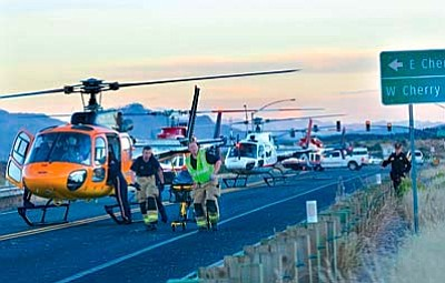 Four medical helicopters sit on Route 260 near the intersection of Cherry Creek Road at about 5 p.m. Friday in Camp Verde, transporting multiple injured people to the hospital after a two-vehicle accident which closed the highway. VVN/Vyto Starinskas