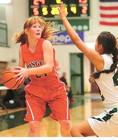 Junior guard Vivian Koeppe faces a Flagstaff defender in Friday's game at Flagstaff High School. The Marauders lost to Flagstaff for the second time this season. Photo courtesy of Taylor Mahoney/Arizona Daily Sun.