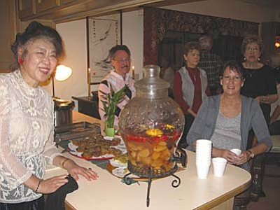 Dr. Lily Chou delights the Sedona United Methodist Church choir with her Chinese specialties.