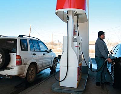 Cottonwood resident Josh Riffel fills his gas tank at the Shell gasoline station on State Route 260. Friday, the Camp Verde Shell charged $2.019 for a gallon of 87-octane unleaded gasoline VVN photo by Bill Helm