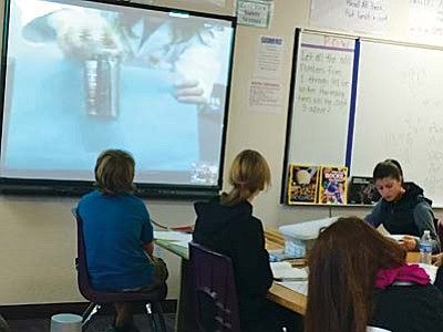 Students in Kelli Rhoda's science class engage in a remote chemicals reaction lab with the Challenger Learning Center.VVN/Yvonne Gonzalez