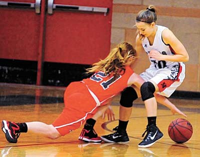 Mingus' Vivian Koeppe (21) tries to recover the ball from behind Bradshaw's Elah Alvis (30) as the Lady Bears take on the Mingus Lady Marauders last Wednesday night in Prescott Valley. Photo courtesy of Les Stukenberg/The Daily Courier