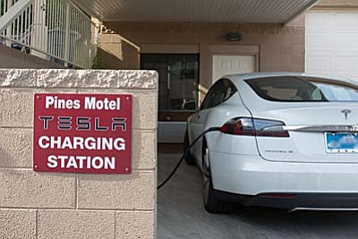 Tesla charging station in use. Pines Motel in Cottonwood now has a Dual Level 2 electric vehicle charging station and also a Tesla Model S charging station.