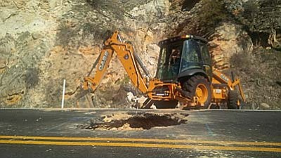 Crews used heavy equipment to excavate a six-foot deep, eight-foot wide section of the roadway to remove loose material underneath the pavement near milepost 388, where the sinkhole was originally spotted on Saturday afternoon on the northbound lane.