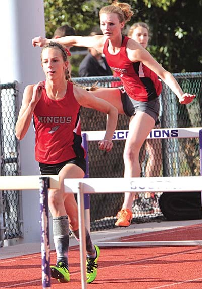 Freshman Hannah DeVore, left, and senior Kylie Streck, compete in the 100-meter hurdles during the Sedona Friendship meet held at Sedona Red Rock High School. VVN/Vyto Starinskas