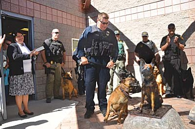 A new Law Enforcement K-9 Heroes Statue was dedicated on Saturday at the Cottonwood Police Department. The statue was modeled after Cottonwood Police Officer Cory Shilling's K-9 named Jax, who is currently on the force, left. VVN/Vyto Starinskas