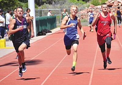 Camp Verde's Jordan Reay (middle) runs against Mingus' Trevor Galloway (right) during the 4x100 meter relay during Saturday's Red Rock Invitational. Camp Verde finished fourth, while Mingus finished fifth. VVN/Vyto Starinskas.