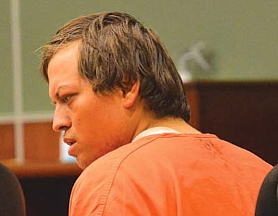 Nathaniel Gaver listens as the criminal charges he is faced with are read to him during Monday's hearing  before Yavapai County Superior Court Judge Michael Bluff Monday. Nathaniel, 27, as did his parents and two brothers, pleaded not guilty to charges that stem from the March 21 brawl and shooting at the Cottonwood Walmart. VVN/Vyto Starinskas