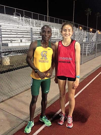 Aftershock distance ace Allyson Arellano and her teammates received a nice surprise after the Mesa Classic when 7-time national champion Harry Mulenga of Central Arizona College visited with the runners. Mulenga had encouraging words for Arellano and said he had been watching her since last year and was a fan. Courtesy photo