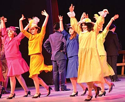 Four-year theater student Gloria Alcala (right, yellow dress) in the Mingus Union theater production of Thoroughly Modern Millie. VVN/Vyto Starinskas