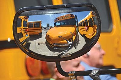 New propane-fueled school buses arrive in Cottonwood Wednesday. The old school buses that will be replaced will be traded-in and taken to Phoenix. VVN/Vyto Starinskas