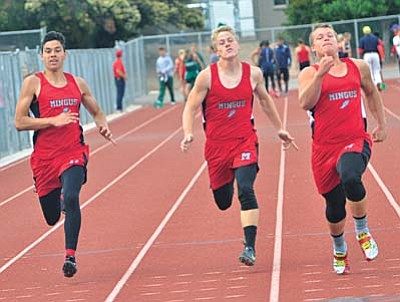 Mingus Jordan Ontiveros, left, Jordan Prouty center and Levi Collins right run the boys 100 meter dash Friday at Mingus Union High School during the Mingus Invitational. VVN/Vyto Starinskas.
