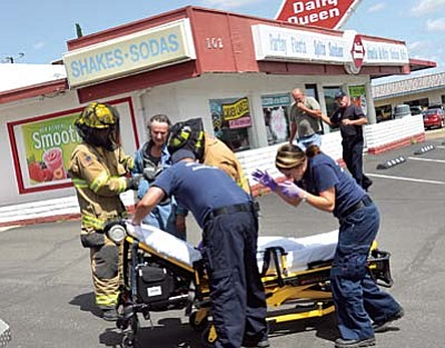 Two people were transported by ambulance after being attacked by bees and taken out of the Cottonwood Dairy Queen. VVN/Vyto Starinskas