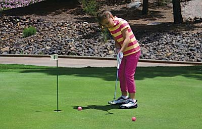 Marissa Flower plays golf at Coyote Trails Golf Course. Marissa learned a lot about golf from her coach Tom Sheely. VVN/Derek Evans