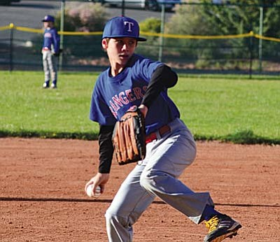 Jehiah Rogers gets ready to pitch for the Verde Valley Texas Rangers during Friday's 14- 11 win over the Sedona Dimondbacks. VVN/Derek Evans
