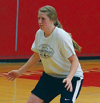 Forward Sharon Rehborg gets into a defensive stance  during Tuesday's practice. Head coach Dave Moncibaez said this is the highest summer turnout the program  has had in a long time. VVN/Derek Evans.