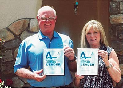 C&B Construction owners Bill and Laurie Bullock display the EPA indoor airPLUS Leader Award for 2015 from the Environmental Protection Agency.. The company has received the award for two consecutive years.