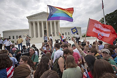 Sam-sex marriage advocates applaud the U.S. Supreme Court's landmark ruling today that makes gay marriage legal in all 50 US states. Associated Press photo