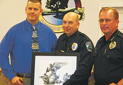 Sgt. Jeremy Daniels, Officer Clint Dobrinski and Police Chief Jody Fanning.