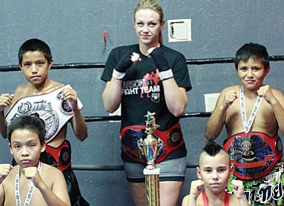 Pictured are fighters from Champs Gym with their belts and medals that they earned at tournaments in Des Moines, Iowa and Orlando, Florida. Back Row: Adam Hines, Lauren Willis, and Avery Hines. Front Row: Kainen Cummings and Ethan Zepeda. VVN photo by Greg Macafee