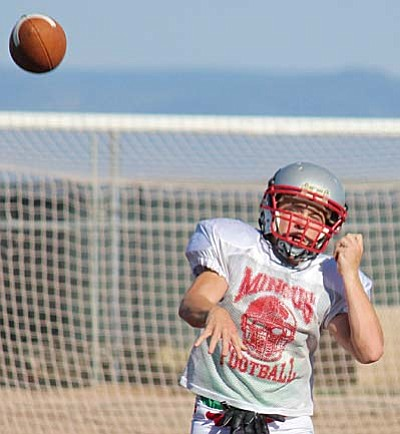 Quarterback Jordan Upham throws a pass to his running back in the flat. VVN photo by Greg Macafee.