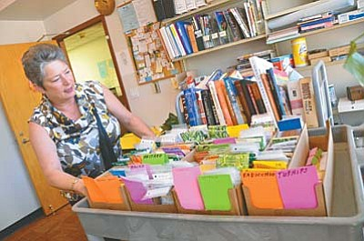 Seeds are being stored and cataloged at the Cottonwood Library as Supervisor Mary Griffith on Wednesday shows how much has been compiled to date. VVN/Vyto Starinskas