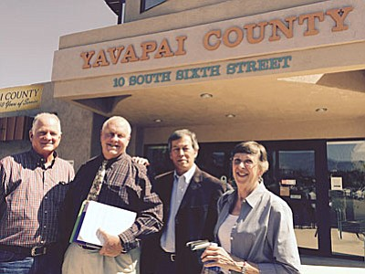 Photo by Tom Tracey<br /><br /><!-- 1upcrlf2 -->Bill Regner, Tim Carter, Al Filardo and Carolyn Fisher discuss their Verde Valley education needs analysis after leaving the county supervisors meeting.