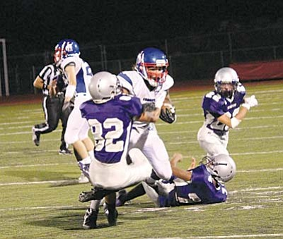 Camp Verde Fullback Jaysen Leonard runs through Sedona defensive back Bailey Ehrlich on one of his nine carries. Leonard finished the night with nine carries for 96 yards, and forced his way into the endzone twice breaking multiple tackles. VVN photo by Greg Macafee.