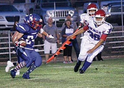 Camp Verde kick-returner Dakota Brueland returns a kick-off Friday night versus Holbrook. Brueland finished the night with 255 all-purpose yards for the Cowboys. He scored the only receving  touchdown for the Cowboys on an 80-yard pass from Trevor Heyer. VVN photo by Greg Macafee.
