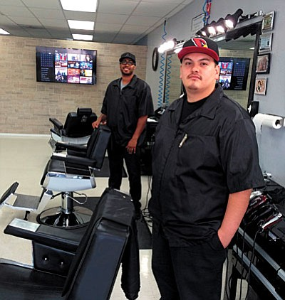 "Elevated Touch owner Anthony Pinn (background) and barber Sergio Tadeo (foreground) blend a contemporary style with an ""Old School"" barber experience. VVN/Tom Tracey"